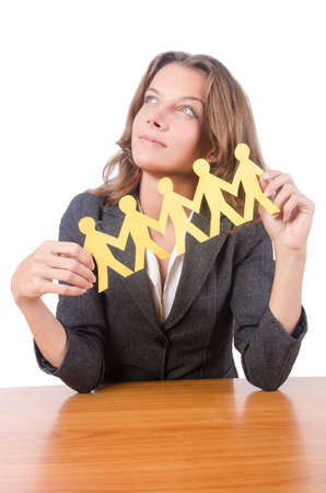 Businesswoman with paper people on white Stock Photo - 16476069