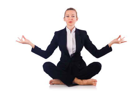 Young businesswoman meditating on the white Stock Photo
