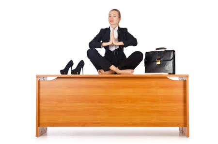 Businesswoman meditating isolated on white photo