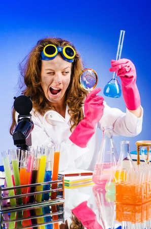 Funny female chemist in lab