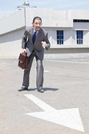 Businessman ready to start running photo