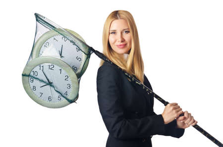 Businesswoman with net and clocks photo