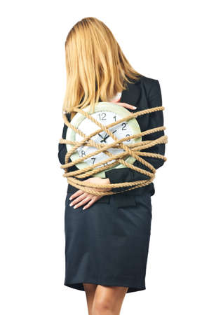 Businesswoman with clock tied up on white Stock Photo - 16934153