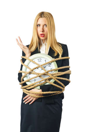 time bound: Businesswoman with clock tied up on white