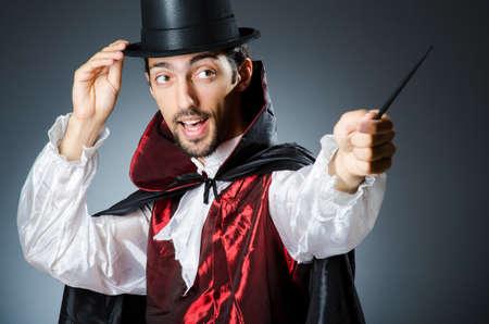 conjuror: Magician doing tricks in dark room