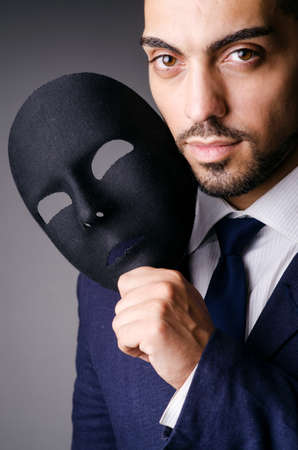 Man with black mask in studio Stock Photo - 16934315