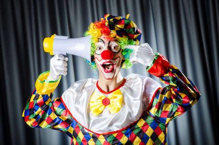 Clown in studio with loudspeaker Stock Photo - 16934314