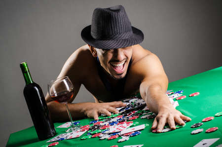 Naked broke businessman in casino Stock Photo - 16934131