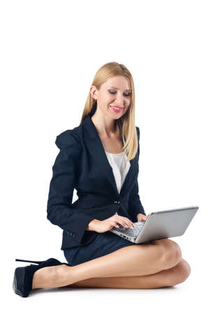 Businesswoman sitting on floor with laptop photo