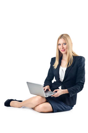 Businesswoman sitting on floor with laptop Stock Photo - 16754474