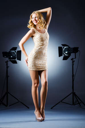Attractive woman in studio shooting photo