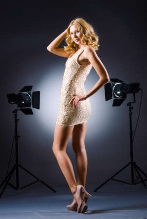 Young attractive woman in photo studio photo