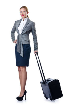 Woman businesswoman with luggage on white photo