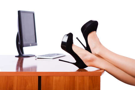 Woman legs on the desk with computer photo