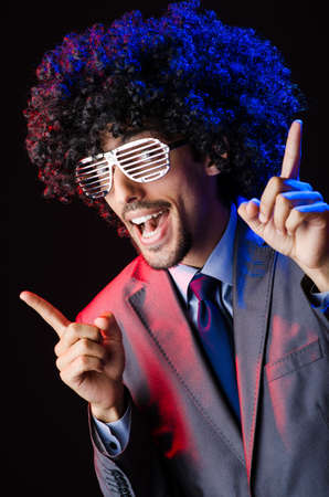 Singer with afro cut in dark studio Stock Photo - 16765211