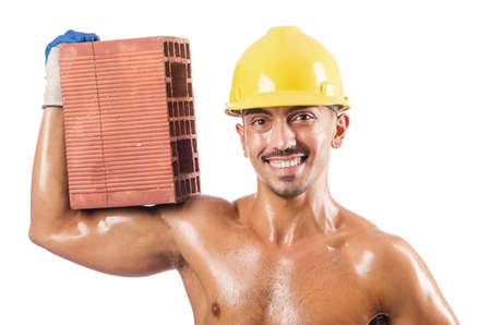 sexy construction worker: Sexy construction worker with bricks