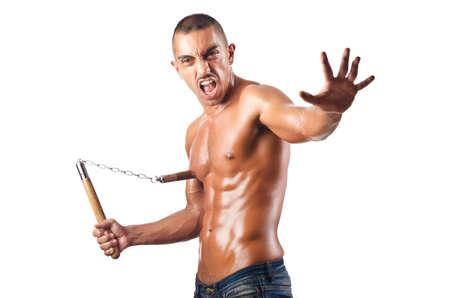 Man in martial arts concept with nunchucks Stock Photo - 16748810