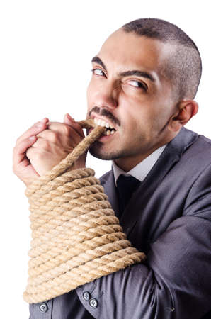 Businessman tied up with rope photo