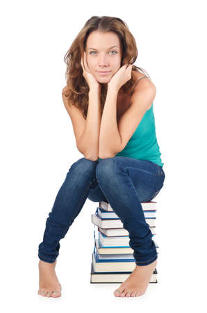 Student sitting on stack of books Stock Photo - 16748933