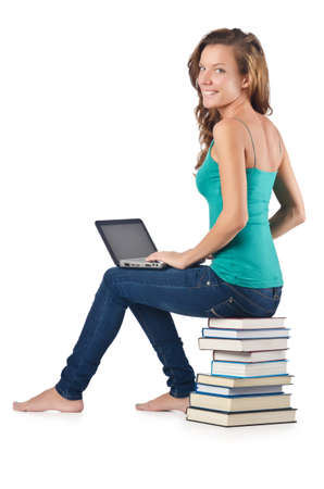 Student with netbook sitting on books Stock Photo - 16748899