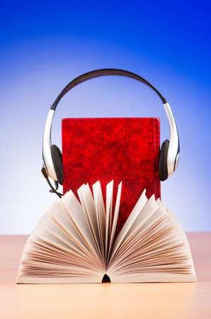 Concept of audio books with earphones on white Stock Photo - 16721587
