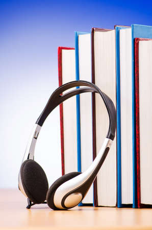 Concept of audio books with earphones on white Stock Photo - 16721748