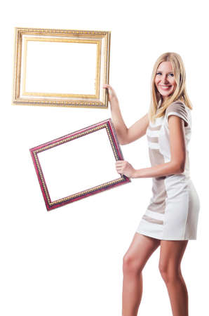 Woman with picture frame on white Stock Photo - 16748853