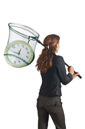 Businesswoman with net and clocks Stock Photo