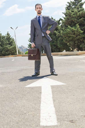 Businessman ready to start running Stock Photo - 16934061