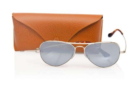 Elegant sunglasses isolated on the white photo