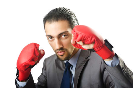 Businessman with boxing gloves on white photo