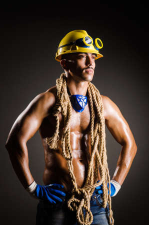 Construction worker in dark studio Stock Photo - 16934281