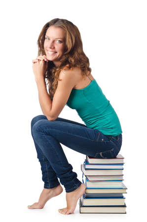Student sitting on stack of books Stock Photo - 16934494