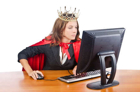 Superwoman worker with crown working in office photo