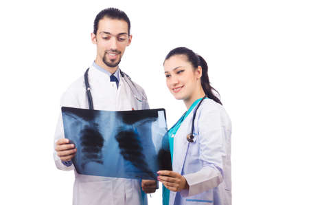 Two doctors looking at x-ray image on white Stock Photo - 16942476