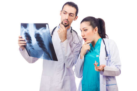 Two doctors looking at x-ray image on white Stock Photo - 16942495