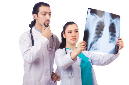 Two doctors looking at x-ray image on white Stock Photo - 16942490
