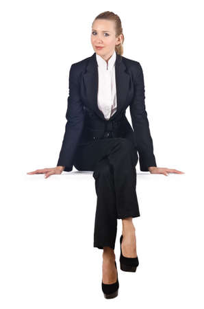 sitting on: Woman businesswoman sitting on virtual wall