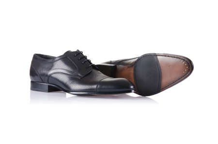 Fashion concept with male shoes on white Stock Photo - 16897341