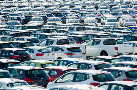 TUSCANY, ITALY - 27 June: New cars parked at distribution center in Tuscany, Italy. This one of biggest distribution centers in Italy. Stock Photo - 17356619