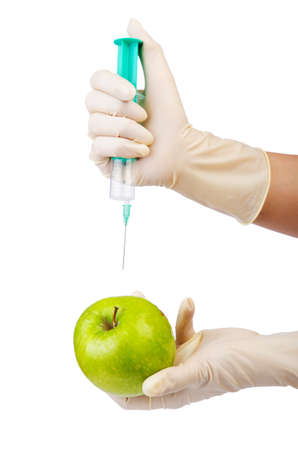 Chemical experiment with apple and syringe photo