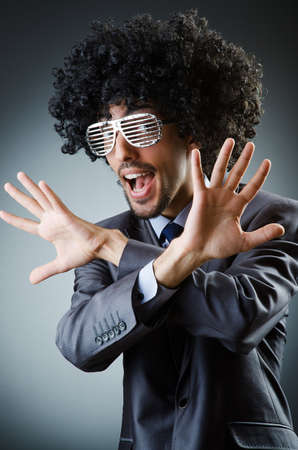Man with afro haircut singing in studio photo