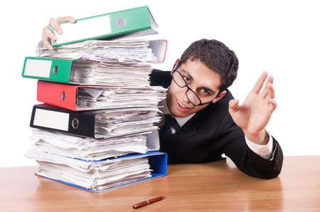 Young busy businessman at his desk Stock Photo - 17389651