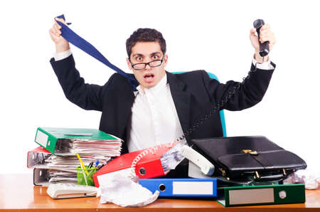 Young busy businessman at his desk Stock Photo - 17389635