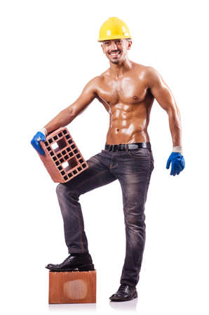 Muscular builder with bricks on white photo