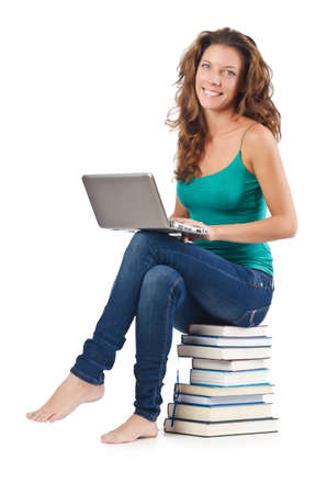 Student with netbook sitting on books Stock Photo - 17373797