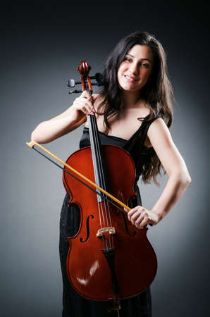 cellist: Woman cellist performing with cello