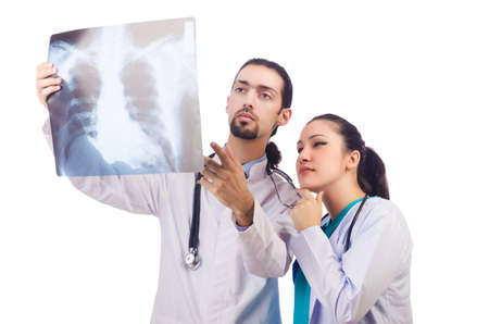 Two doctors looking at x-ray image on white photo