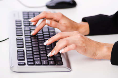 Hands working on the keyboard Stock Photo - 17373857