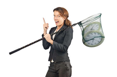 Businesswoman with net and clocks Stock Photo - 18037462